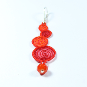 Boucles spirales  corail rouge orange détail